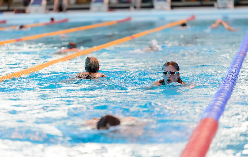 Adults swimming
